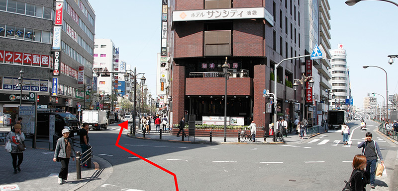 After leaving Ikebukuro Station's North Exit, go down the road to the left of Hotel Sun City Ikebukuro.