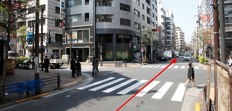After crossing directly over the first intersection, you will see a Hosendo drug store on your left.
